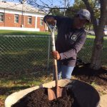 Marnitta Cleaning up the Community and planting flowers