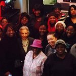 Marnitta leading black history tour with residents stopping at Benns Chili Bowl